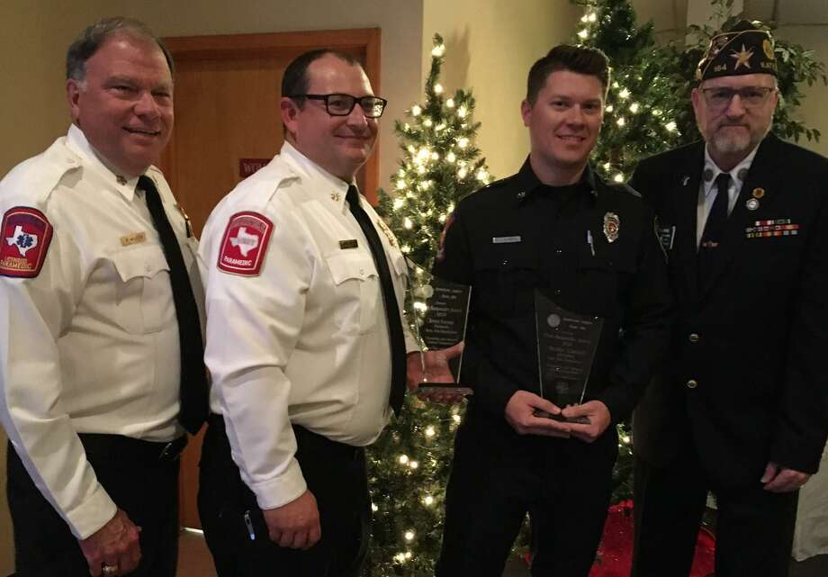 Katy American Post 164 honored the Katy Fire Department's firefighter of the year Nicolas Campbell and paramedic of the year Jesus Sayago at its annual First Responders Awards dinner. From left are Russell Wilson, Katy fire chief; Jacob Duke, battalion chief; Campbell and Jim McGuire, post commander. Sayago was unable to attend the dinner. Photo: Karen Zurawski / Karen Zurawski