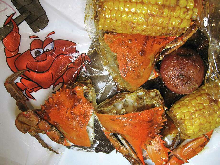 Blue crab is one of the seafood boil options, with corn and potatoes for an extra charge, at Smashin' Crab. Photo: Mike Sutter /Staff