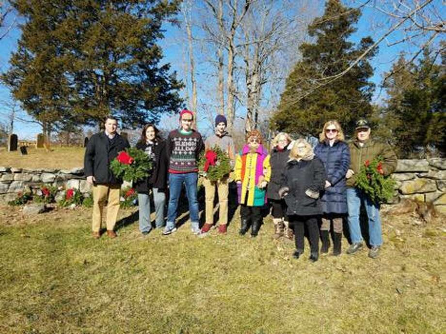 Participating in the 2018 Wreaths Across America ceremony at Sharp Hill Cemetery are Josh Cole, Pam Brown, Dylan Pojano, Julian Pojano, Mary Bendix and four unidentified individuals. Photo: Contributed Photo / Children Of The American Revolut / Wilton Bulletin Contributed