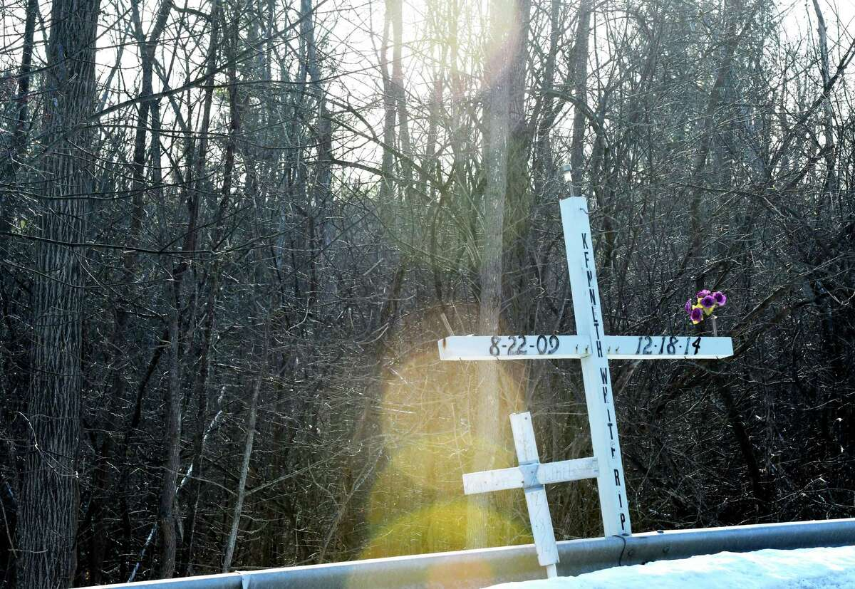 A large cross was placed by members of Kenneth?•s Army, a child victim advocacy group formed following the death of Kenneth White, 5, in 2014, was placed at the fatal site where White's body was found on Thursday, Dec. 12, 2019, in Knox, N.Y. The group works quietly in Albany County's hilltowns to provide necessities for children in need. White was killed by teenage cousin, Tiffany VanAlstyne, and dumped across the road in a snowbank. (Will Waldron/Times Union)