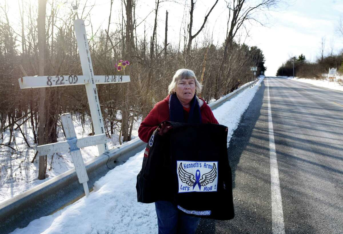 Claire Ansbro-Ingalls, member of Kenneth's Army, a child victim advocacy group formed following the death of Kenneth White, 5, in 2014, stands next to a memorial placed at the fatal site where White's body was found on Thursday, Dec. 12, 2019, in Knox, N.Y. The group works quietly in Albany County's hilltowns to provide necessities for children in need. White was killed by teenage cousin, Tiffany VanAlstyne, and dumped across the road in a snowbank. (Will Waldron/Times Union)