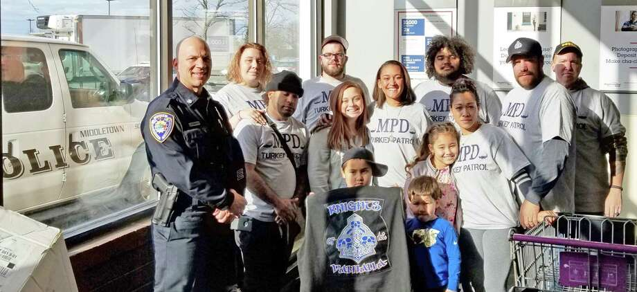 Members of the Knights of Valhalla Car Club of Middletown took part in the Thanksgiving turkey drive at Price Chopper alongside Middletown police officers in 2018. Photo: Contributed Photo
