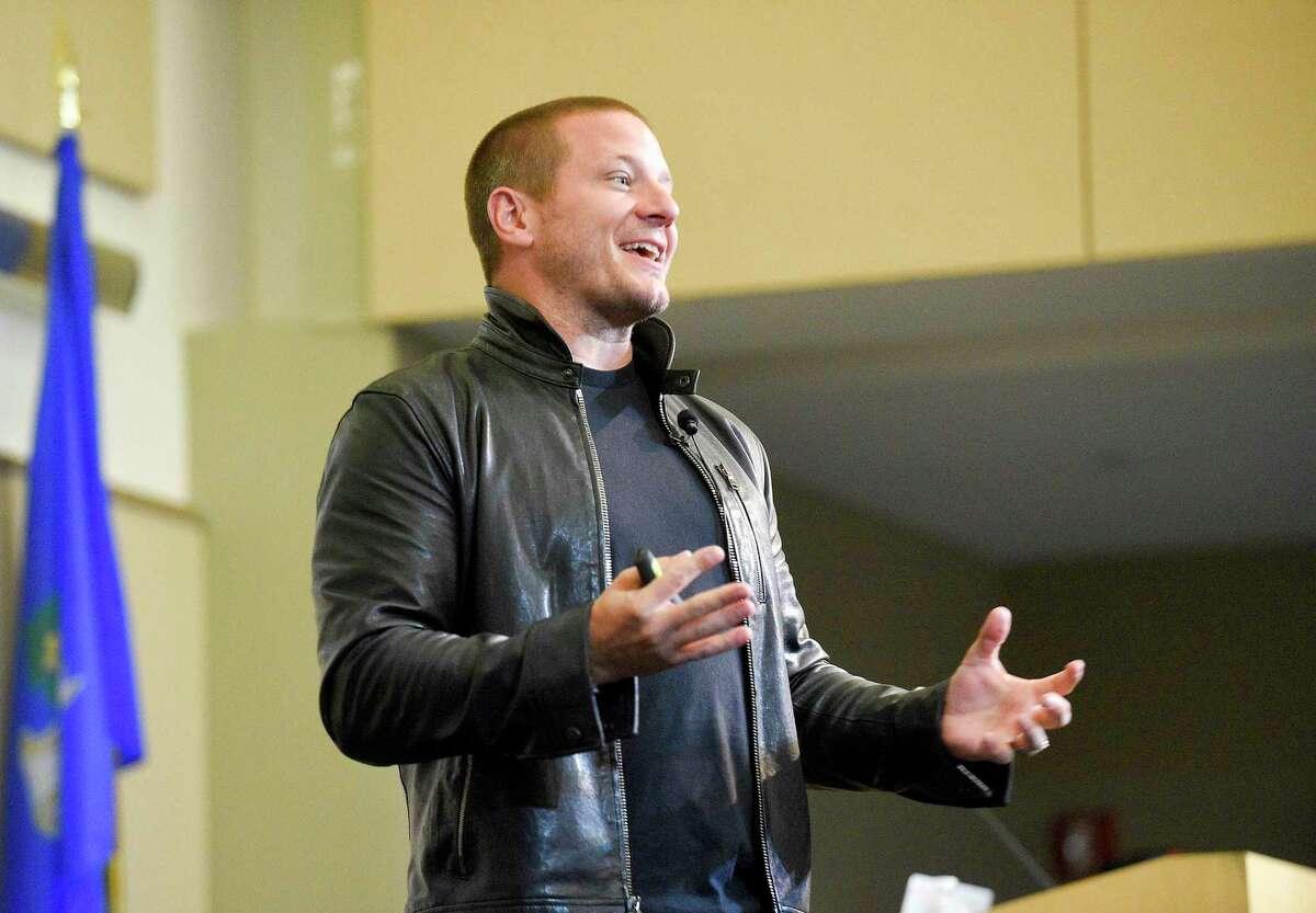 Shawn Nelson, founder and CEO of furniture company Lovesac, gives a speech in the UConn-Stamford's Gen Re auditorium, as part of the FastFWD conference on Sept. 27, 2019.