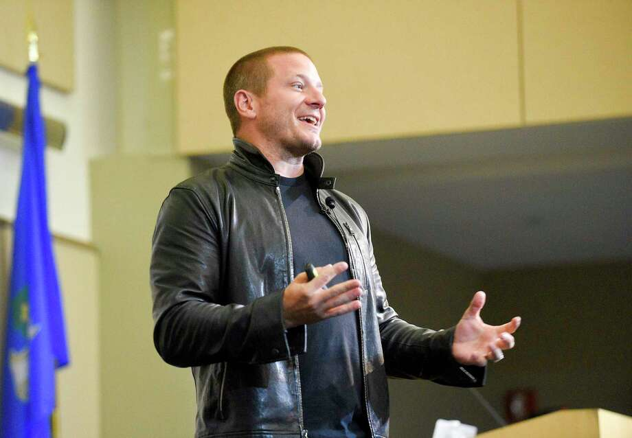 Shawn Nelson, founder and CEO of furniture company Lovesac, gives a speech in the UConn-Stamford's Gen Re auditorium, as part of the FastFWD conference on Sept. 27, 2019. Photo: File / Matthew Brown / Hearst Connecticut Media / Stamford Advocate