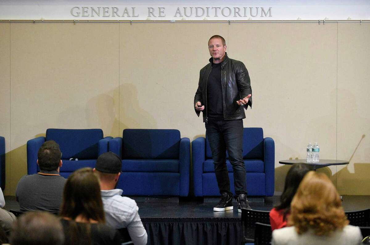 Shawn Nelson, founder and CEO of furniture company Lovesac, gives a speech in the UConn-Stamford Gen Re auditorium, during the FastFWD conference on Sept. 27, 2019.