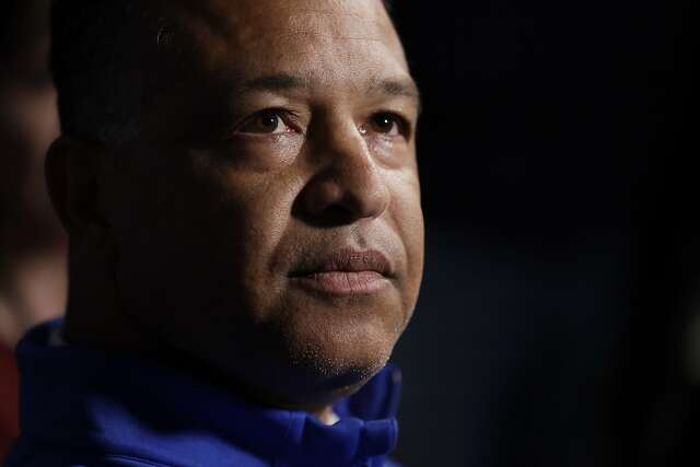 Los Angeles Dodgers manager Dave Roberts listens to a question during the Major League Baseball winter meetings, Tuesday, Dec. 10, 2019, in San Diego. (AP Photo/Gregory Bull)