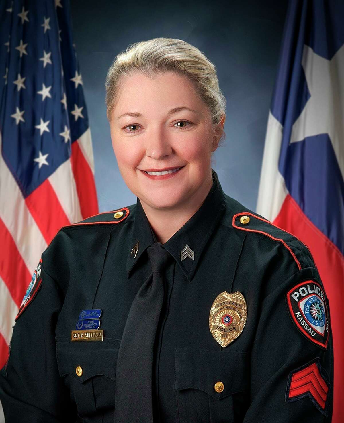 This undated photo provided by the City of Nassau Bay shows Nassau Bay Police Sgt. Kaila Sullivan, who died Tuesday night, Dec. 10, 2019, when she was struck by a vehicle fleeing a traffic stop, in Nassau Bay, Texas. Sullivan, 43, had worked for the Nassau Bay Police Department for more than 15 years. (City of Nassau Bay via AP)