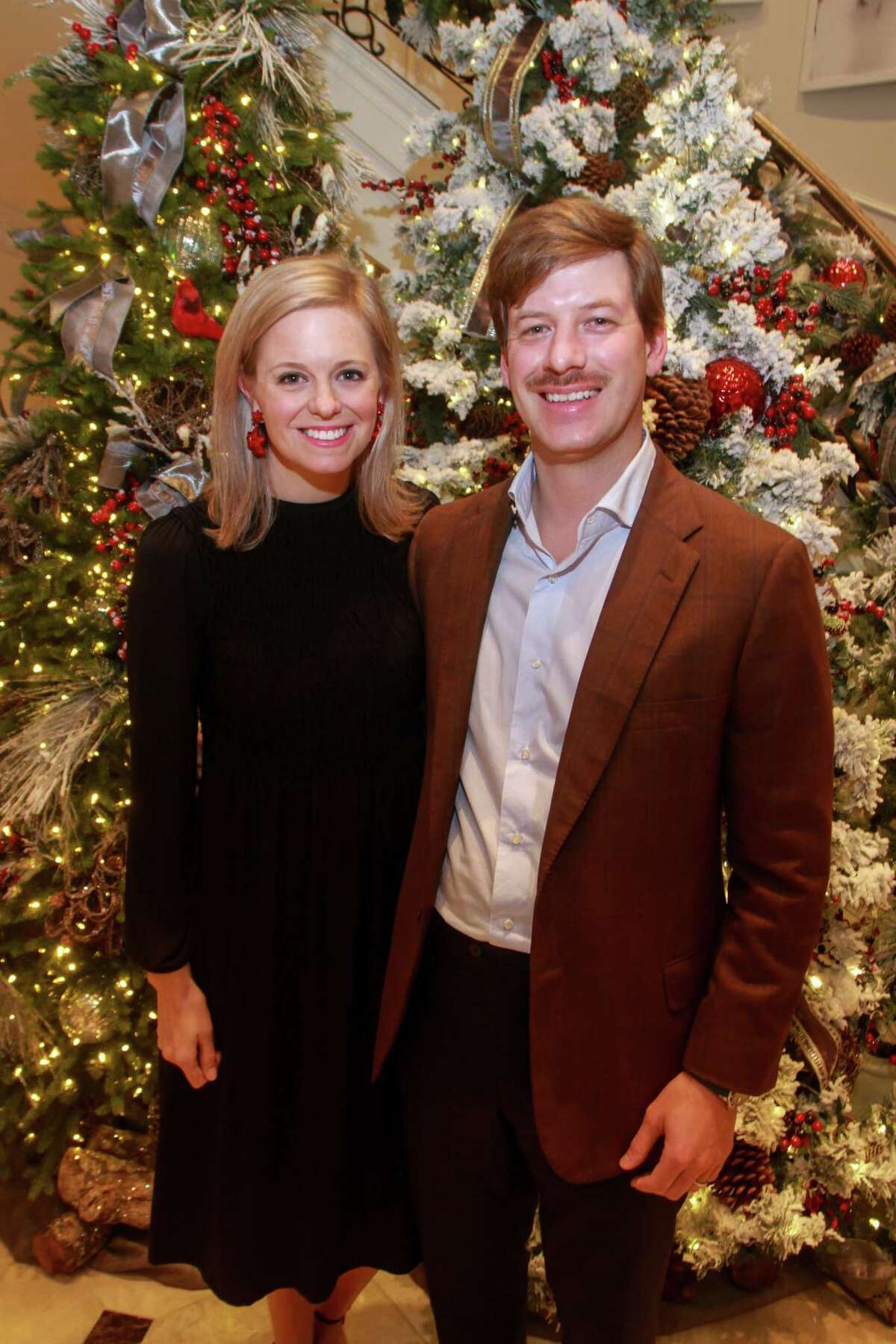 Sarah and Travis Covington at Santa's Elves, benefiting MD Anderson, in Houston on December 5, 2019.