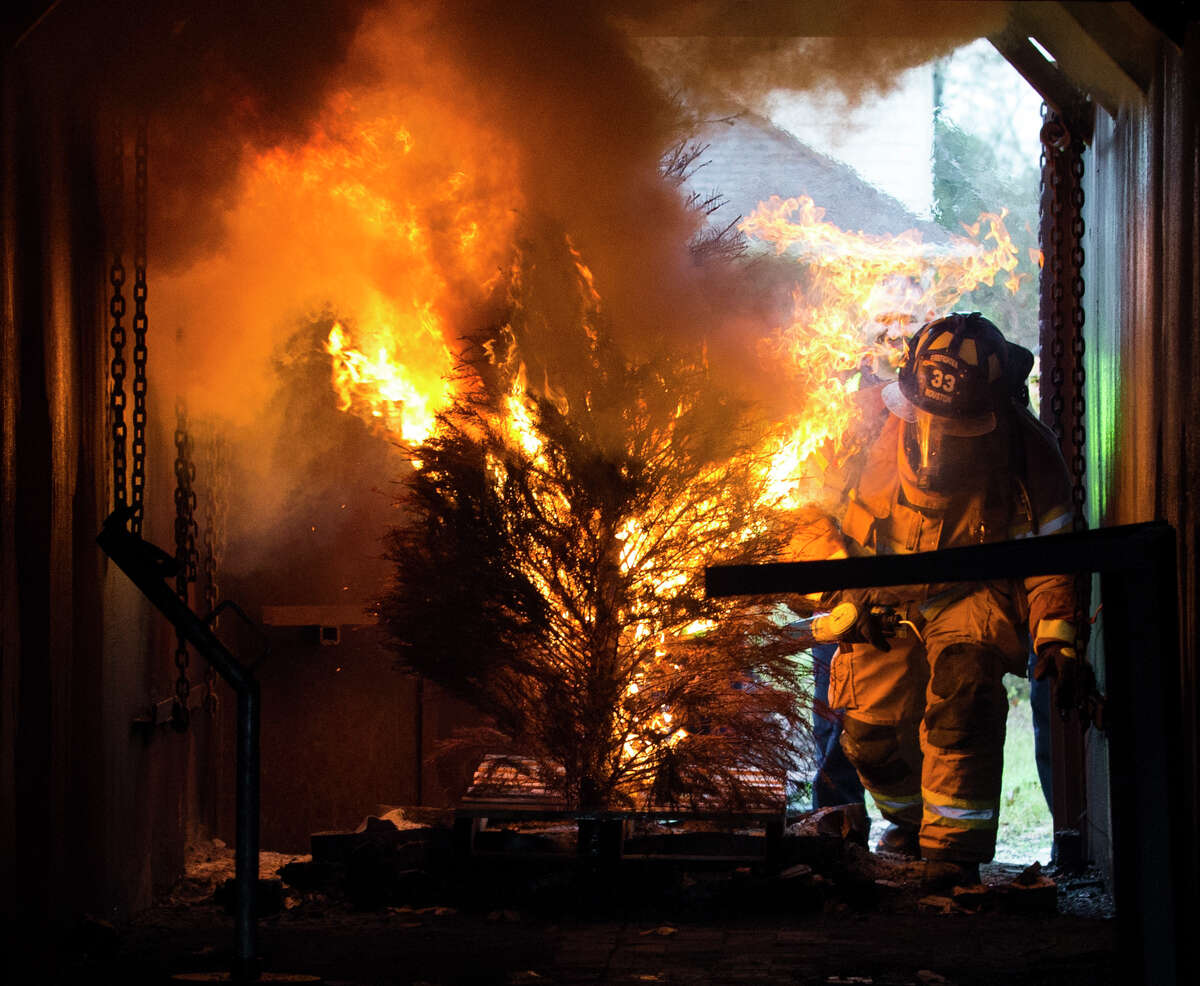 The Houston Fire Department firefighters demonstrates how quickly and easily a Christmas tree can catch fire and burn at the HFD Training Academy on Tuesday, Dec. 10, 2019, in Houston. HFD partnered with Houston Apartment Association to raise awareness, provide safety and decoration tips for the Holiday season. Last December, more than 80 home and apartment fires happened in the City of Houston and caused more than $3 million in estimated damage.