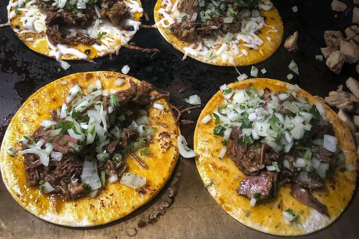 Birria tacos being grilled at Tacos El Patr-n in San Francisco, Calif.