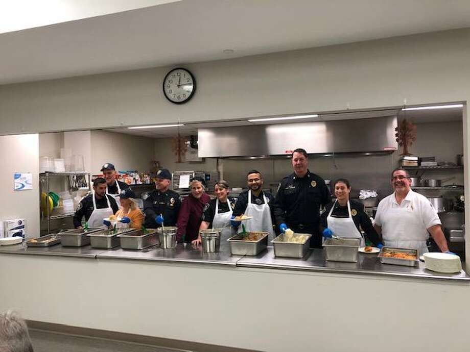 Darien's senior center thanked servers of its Thanksgiving luncheon, above including town officials and members of the Darien Police Department. Photo: Contributed Photo