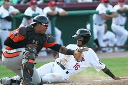 Tri-City ValleyCats' Jonathan Arauz (16) scores as he slides past Aberdeen Ironbirds' catcher Jean Carrillo (51) during a minor league baseball game on Sunday, Aug. 6, 2017, in Troy, N.Y.