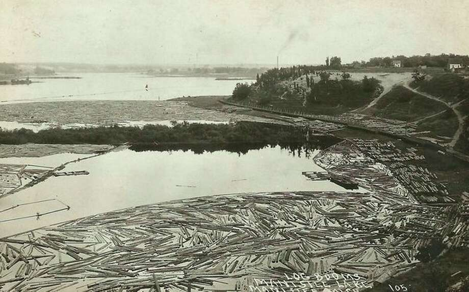 During the height of the lumber era it was common to see Manistee Lake filled with logs in several locations that had been floated down the Manistee River to the sawmills.