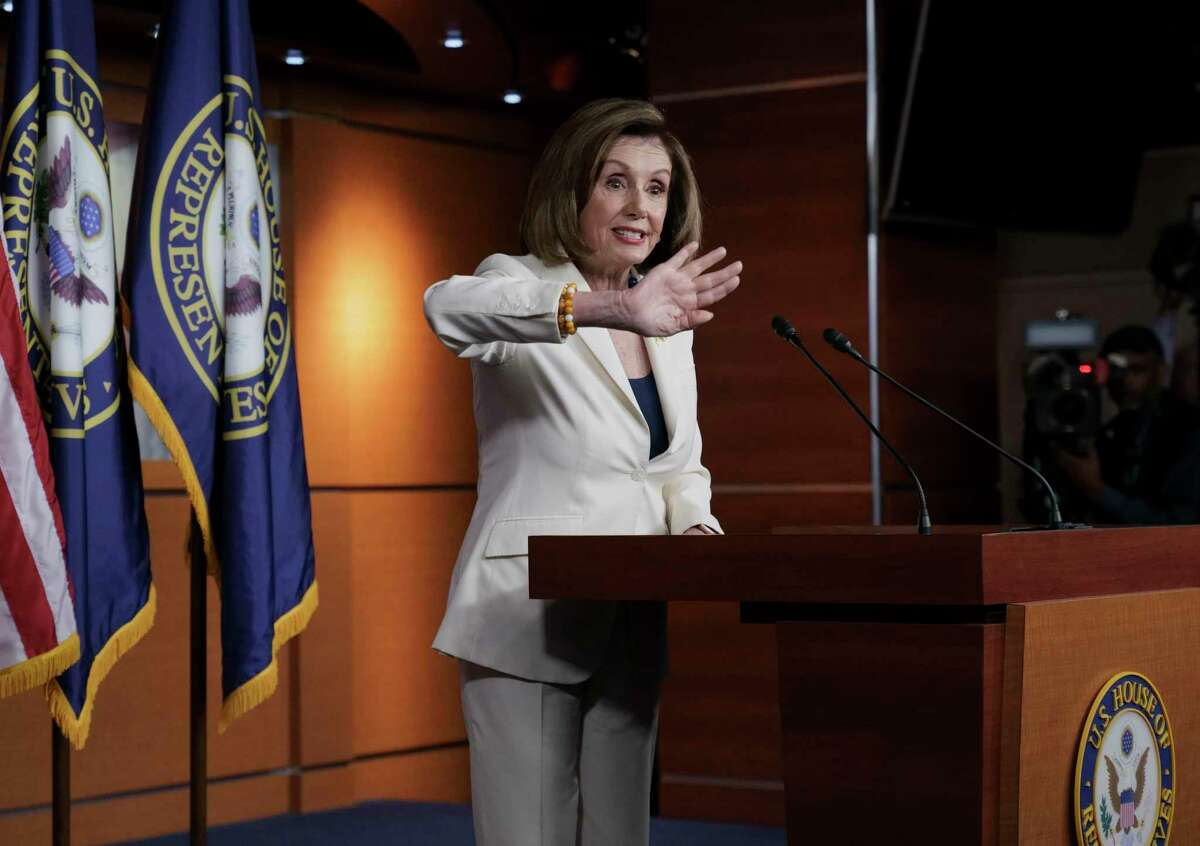 Speaker of the House Nancy Pelosi, D-Calif., responds forcefully to a question from a reporter who asked if she hated President Trump, after announcing earlier that the House is moving forward to draft articles of impeachment against Trump, at the Capitol on Dec. 5.