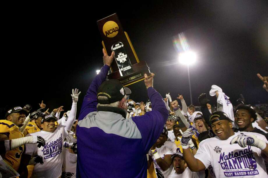 Mary Hardin-Baylor head coach Pete Fredenburg holds up the NCAA Division III college football championship trophy after defeating Mount Union 24-16 to win the Stagg Bowl at Woodforest Bank Stadium, Friday, Dec. 14, 2018, in Shenandoah. Photo: Jason Fochtman, Houston Chronicle / Staff Photographer / © 2018 Houston Chronicle