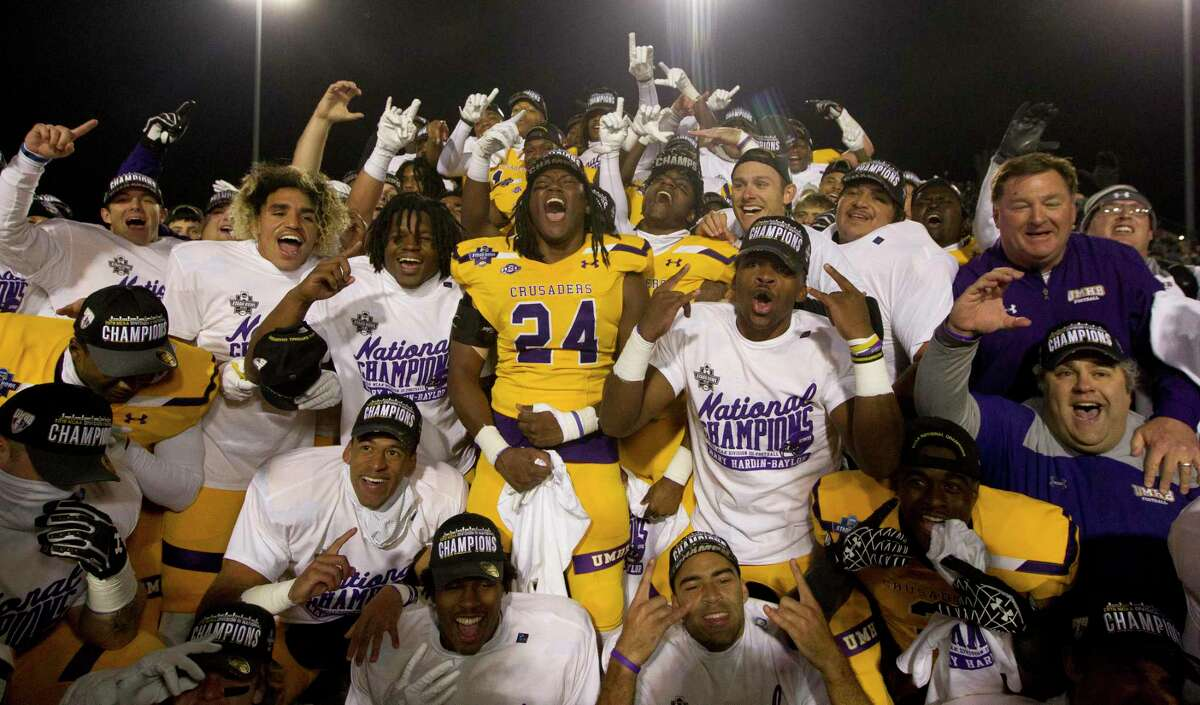 Mary Hardin-Baylor players react after defeating Mount Union 24-16 to win the Stagg Bowl NCAA Division III college football championship at Woodforest Bank Stadium, Friday, Dec. 14, 2018, in Shenandoah.