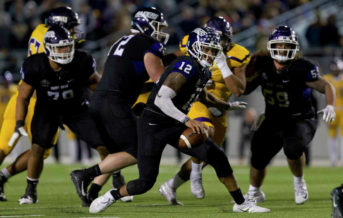 Mount Union quarterback D'Angelo Fulford (12) runs the ball during the fourth quarter of the Stagg Bowl NCAA Division III college football championship at Woodforest Bank Stadium, Friday, Dec. 14, 2018, in Shenandoah.