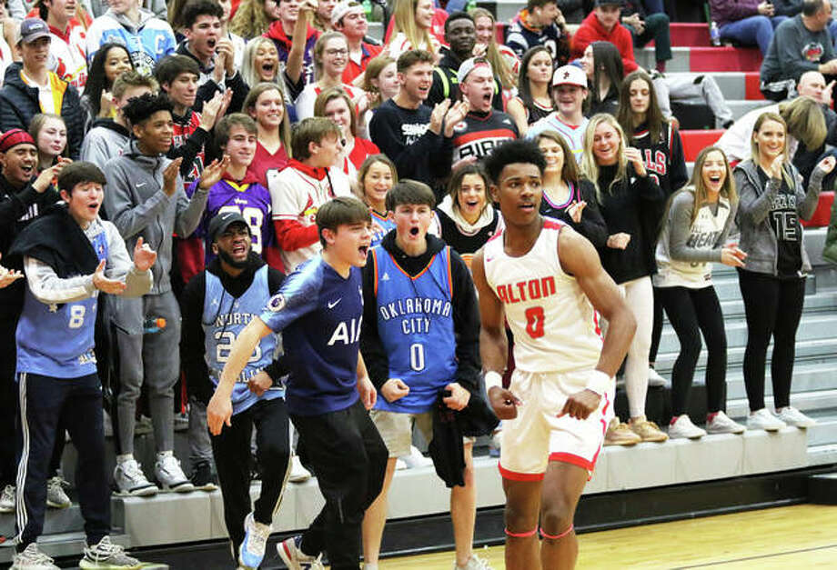 Alton's Moory Woods returns to court after a quick celebration with the Redbirds Nest student section after a teammate scored and was fouled on a fastbreak on Tuesday night in a Southwestern Conference boys basketball game against O'Fallon at Alton High in Godfrey. The 4-2 Redbirds return to SWC play at home Friday when East St. Louis visits AHS. Photo: Greg Shashack / The Telegraph