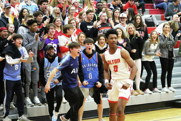 Alton's Moory Woods returns to court after a quick celebration with the Redbirds Nest student section after a teammate scored and was fouled on a fastbreak on Tuesday night in a Southwestern Conference boys basketball game against O'Fallon at Alton High in Godfrey. The 4-2 Redbirds return to SWC play at home Friday when East St. Louis visits AHS.