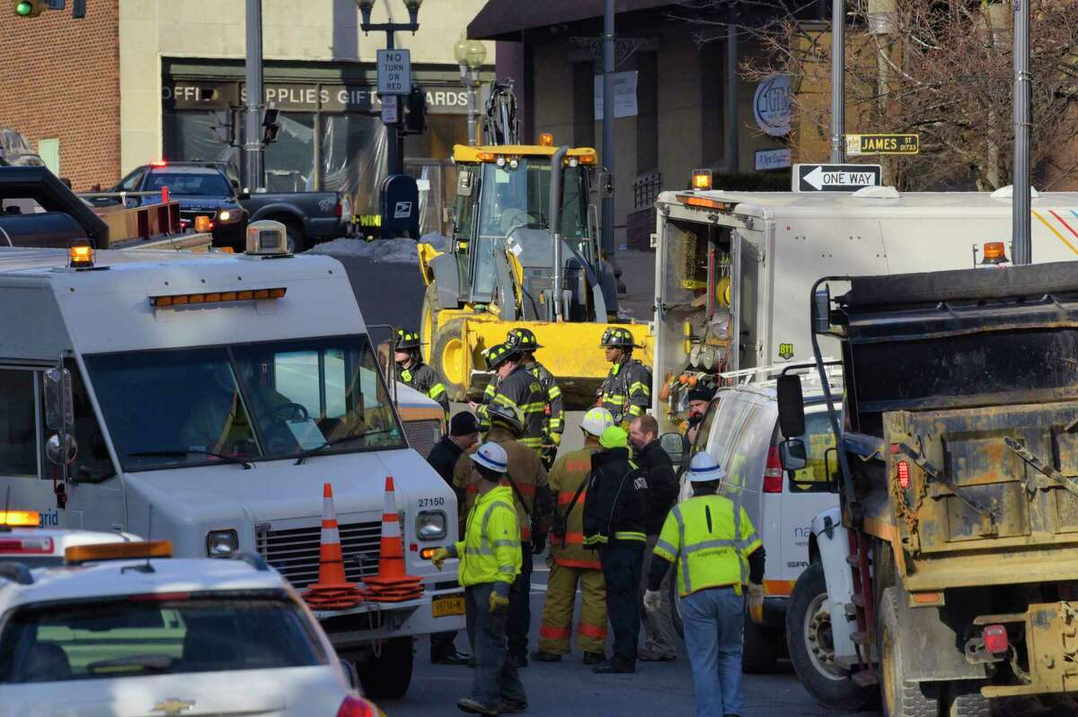 National Grid crews and Albany firefighters work at the scene of a gas leak on James Street on Thursday, Dec. 12, 2019, in Albany, N.Y. Home heating bills are expected to rise 31 percent this winter. (Paul Buckowski/Times Union)