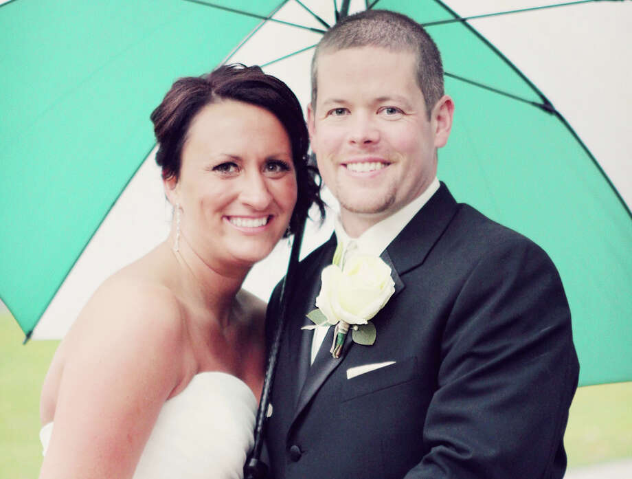 Kali (Burch) McKenna and her husband Travis on their wedding day in 2012. Photo: Photo Provided