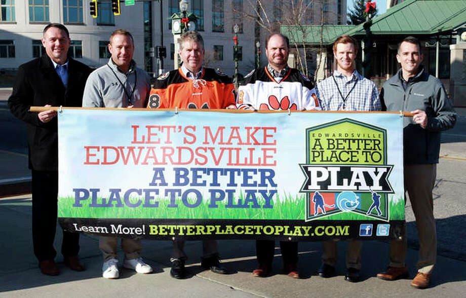 From left are City Administrator Kevin Head; EHS Track Coach Chad Lakatos; Mayor Hal Patton; Randy Gori of The Gori Law Firm, Gori, Realtors and Gori Property Management; Edwardsville High School Hockey Coach Jason Walker; and Parks and Recreation Director Nate Tingley. Photo: Courtesy Of Cork Tree Creative