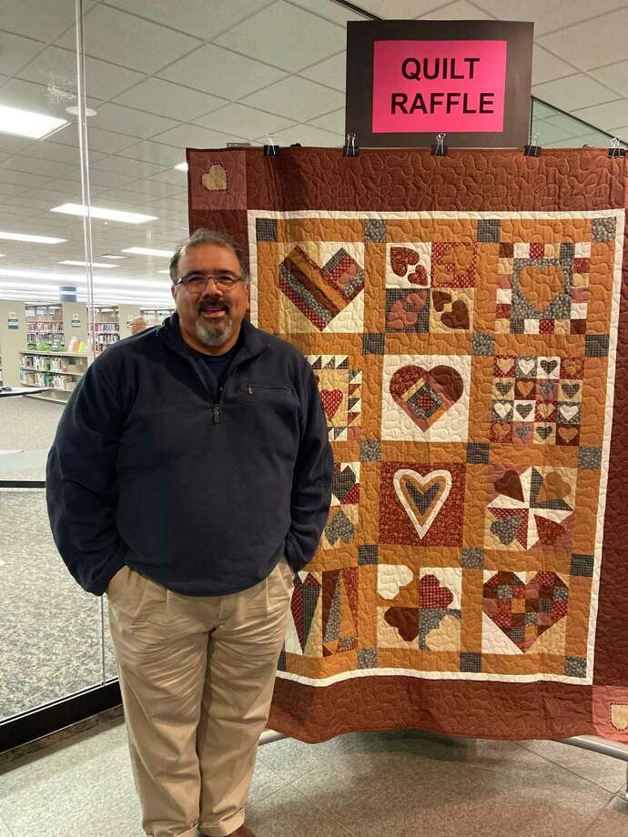 "Lee Lytle of Rosenberg was the winner of the Friends of George Memorial Library's ""Love Your Library Quilt Raffle,"" with the winning ticket was drawn at the library's WinterFest on Dec. 7. Photo: Courtesy Photo"