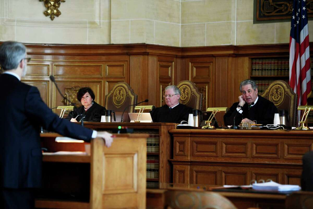 Justices listen to arguments by Senior Assistant State's Attorney Robert Scheinblum, left, concerning the gag order imposed in the Fotis Dulos case at the Connecticut State Supreme Court in Hartford, Conn. on Thursday, December 12, 2019. The justices from left are Maria Kahn, Gregory D'Auria, and Richard Palmer.