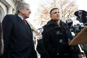 After arguing in front of the Connecticut State Supreme Court to strike down the gag order in the case of his client, Fotis Dulos, Attorney Norm Pattis, left, addresses the media with Dulos on the courthouse steps in Hartford, Conn. on Thursday, December 12, 2019.