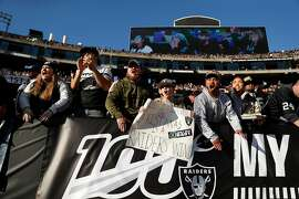 Oakland Raiders' fans cheer in 3rd quarter of Raiders' 42-21 loss to Tennessee Titans in NFL game at Oakland Coliseum in Oakland, Calif., on Sunday, December 8, 2019.