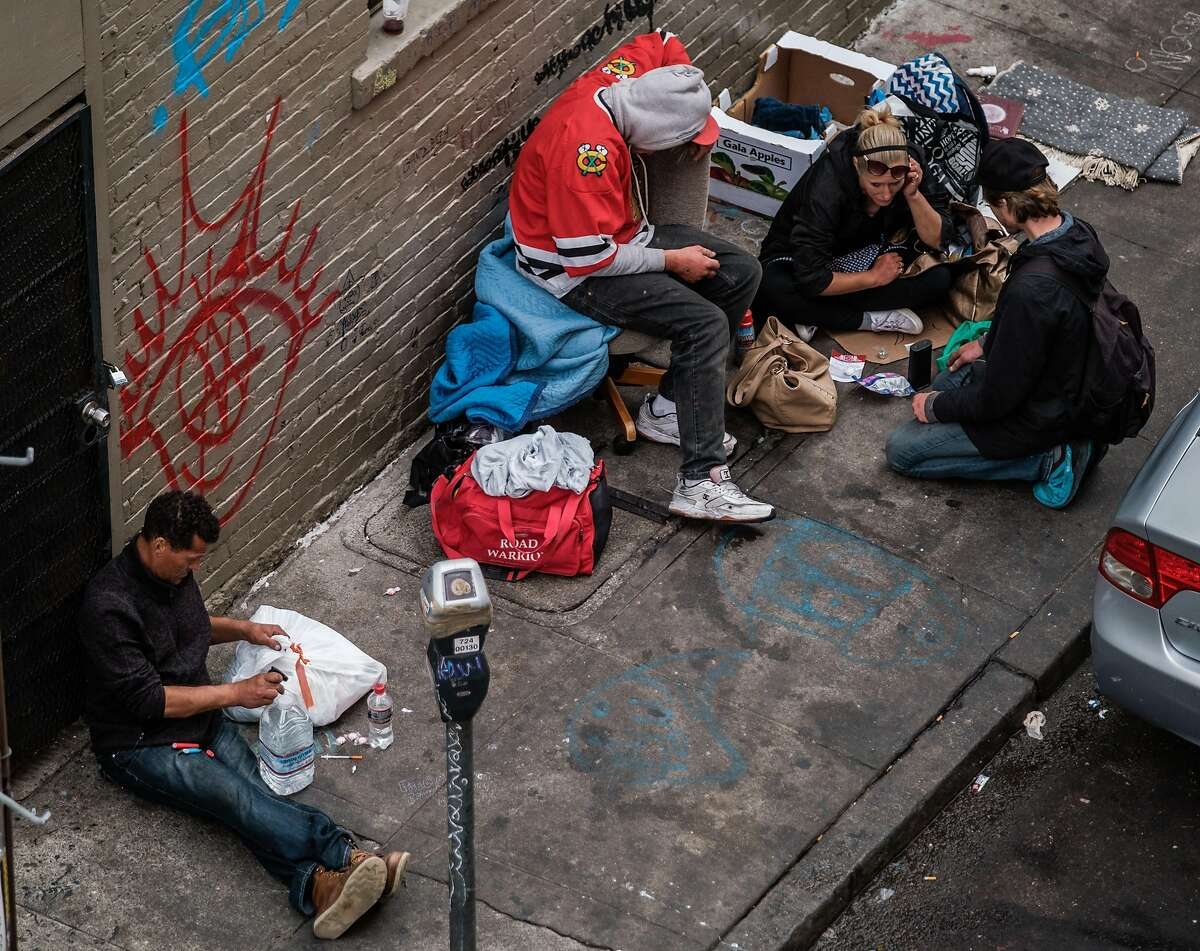 Drug users are seen on Willow Street, in San Francisco, Calif. on Thursday, October 16, 2019.
