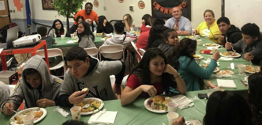 Students who recently immigrated to the United States enjoy their First Thanksgiving celebration November 27. Photo by Leila Rajcoomar. Photo: Contributed / Contributed Photo / Westport News contributed