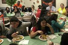 Students who recently immigrated to the United States enjoy their First Thanksgiving celebration November 27. Photo by Leila Rajcoomar.