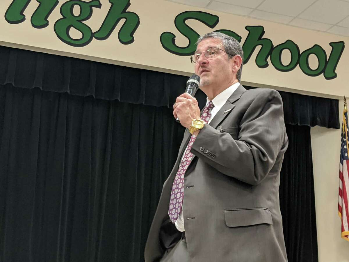 Dr. Chris Hines presents the goals and reasoning behind the rezoning process for several elementary schools in The Woodlands at a meeting Dec. 11, 2019.