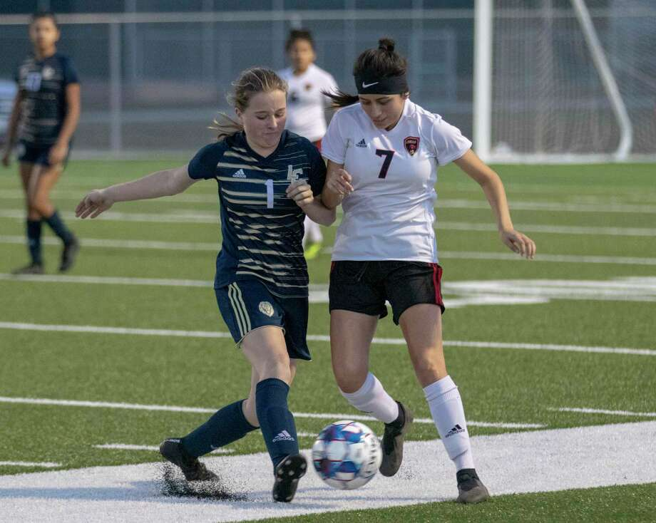 Lake Creek midfielder Camryn Robbins (1) and Caney Creek junior Karla Ramos (7) compete for the ball during a District 20-5A high school soccer game Friday, Feb. 15, 2019 at Lake Creek High School in Montgomery. Photo: Cody Bahn, Houston Chronicle / Staff Photographer / © 2018 Houston Chronicle