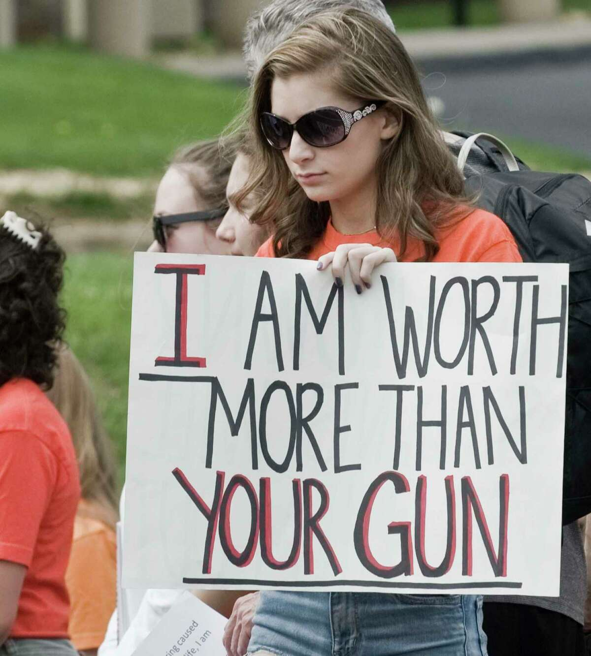 Isabella Wakeman, a junior at Newtown High School, protests with the Junior Newtown Action Alliance at the National Shooting Sports Foundation in Newtown May 5, 2018