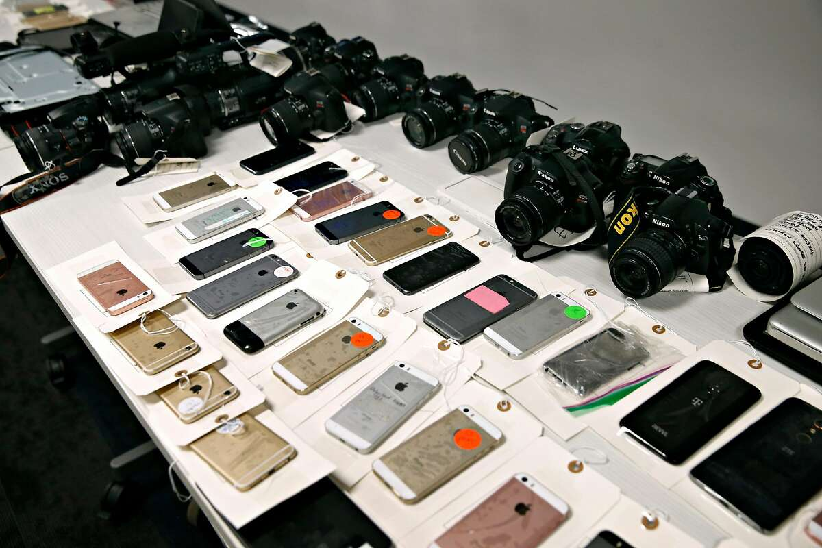 Cell phones and digital cameras are displayed at a news conference at the District Attorney's office in San Francisco, Calif. on Thursday, Dec. 12, 2019 to announce the seizure of more than $2 million of stolen property following a multi-agency investigation called Operation Focus Lens.