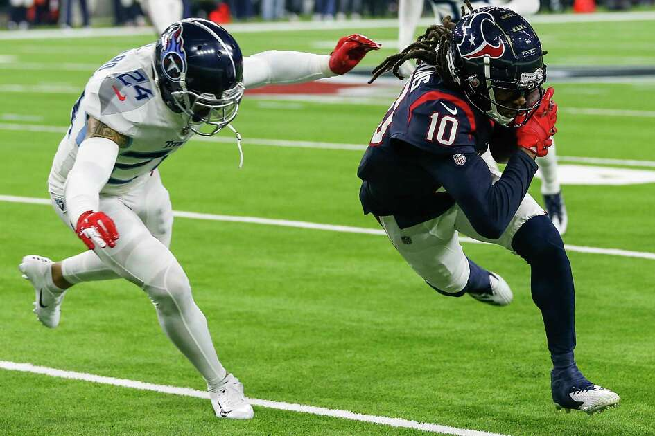 Houston Texans wide receiver DeAndre Hopkins (10) makes a first down reception with Tennessee Titans strong safety Kenny Vaccaro (24) defending during the first quarter of an NFL football game at NRG Stadium on Monday, Nov. 26, 2018, in Houston.