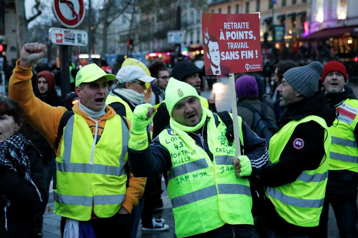 Yellow-vest activists protest against government policies in Paris. Labor unions have flatly rejected President Emmanuel Macron's move to overhaul the nation's pension system.