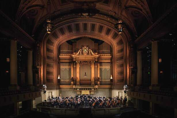 A view from the balcony of Woolsey Hall during a symphony concert.