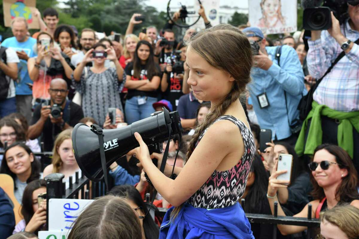 Swedish climate activist Greta Thunberg speaks outside the White House in September. The teenager was named Time magazine's person of the year, which annoyed President Trump.
