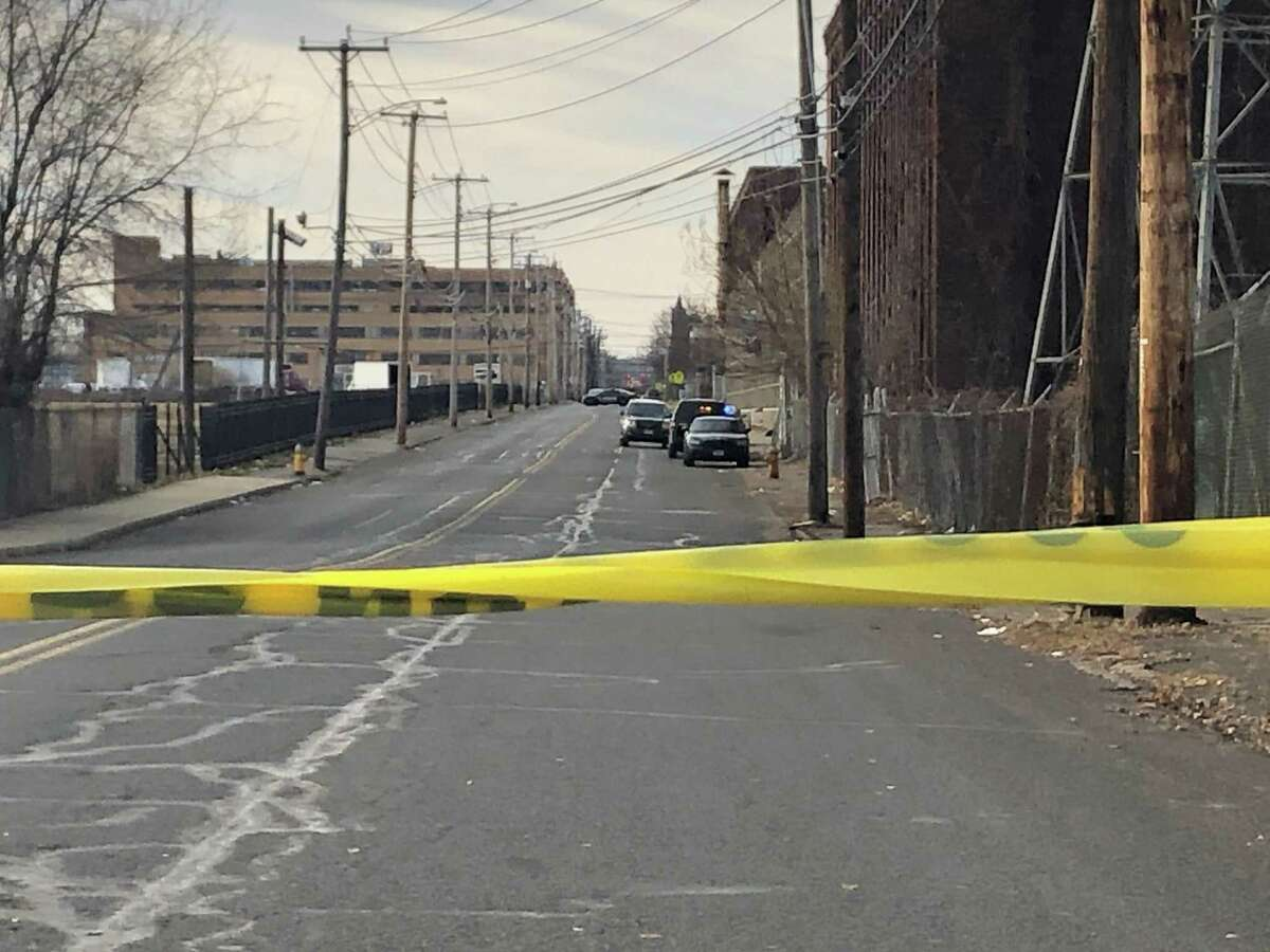 Police investigate the discovery of a body near the former Remington Arms factory Dec. 8, 2019.