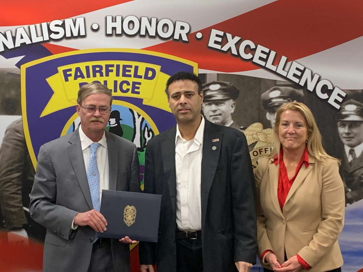 Police Lieutenant James Perez, center was honored by the town of Fairfield for saving a heart attack patient's life. He's shown here with Police Chief Christopher Lyddy and First Selectman Brenda Kupchick.