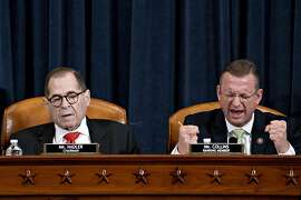 WASHINGTON, DC - DECEMBER 12: Ranking member Rep. Doug Collins (R-GA) (R) speaks as House Judiciary Committee Chairman Jerry Nadler (D-NY) listens during a House Judiciary Committee markup hearing on the Articles of Impeachment against President Donald Trump at the Longworth House Office Building on Thursday December 12, 2019 in Washington, DC. The articles of impeachment charge Trump with abuse of power and obstruction of Congress. House Democrats claim that Trump posed a 'clear and present danger' to national security and the 2020 election in his dealings with Ukraine over the past year. (Photo by Andrew Harrer - Pool/Getty Images) *** BESTPIX ***