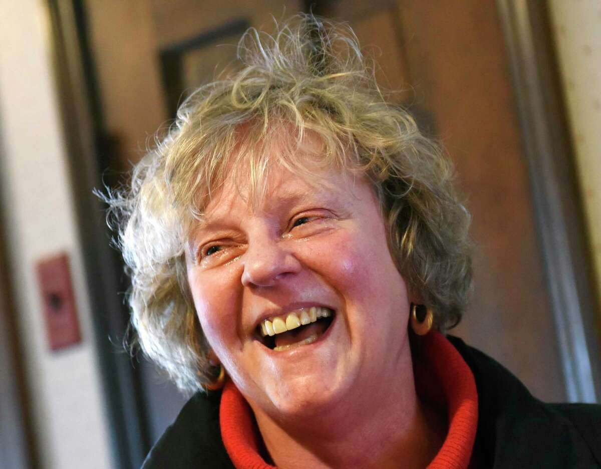 Cathy Ostuw, co-founder of Building One Community, is surprised at a friend's home in Stamford, Conn. to learn that she is this year's Stamford Citizen of the Year winner on Thursday, Dec. 12, 2019. Ostuw was heading to her weekly Scrabble game with friends when Mayor David Martin and dozens of friends and colleagues suprised her with the honor, which is sponsored by Post 142 of the Jewish War Veterans of the United States. Building One Community's mission is to advance the successful integration of immigrants and their families.