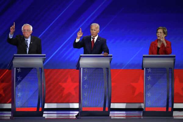 HOUSTON, TEXAS - SEPTEMBER 12: Democratic presidential candidates Sen. Bernie Sanders (I-VT), former Vice President Joe Biden, and Sen. Elizabeth Warren (D-MA) raise their hands during the Democratic Presidential Debate at Texas Southern University's Health and PE Center on September 12, 2019 in Houston, Texas. Ten Democratic presidential hopefuls were chosen from the larger field of candidates to participate in the debate hosted by ABC News in partnership with Univision. (Photo by Win McNamee/Getty Images)