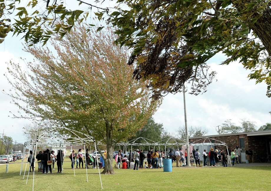 A long line of area residents waiting to file claims at the armory in Port Neches Monday, many bringing chairs to sit in as they wait time was nearly two hours by early afternoon.  Photo taken Monday, December 9, 2019 Kim Brent/The Enterprise Photo: Kim Brent / The Enterprise / BEN