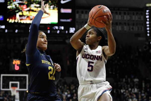 Connecticut's Crystal Dangerfield looks to shoot as Notre Dame's Anaya Peoples, left, defends, in the second half of an NCAA college basketball game, Sunday, Dec. 8, 2019, in Storrs, Conn. (AP Photo/Jessica Hill)
