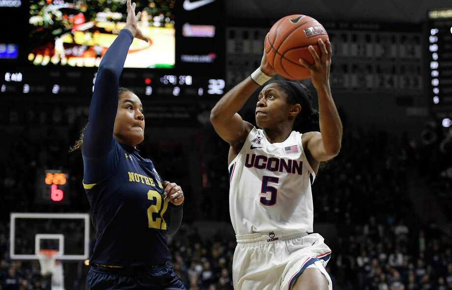 Connecticut's Crystal Dangerfield looks to shoot as Notre Dame's Anaya Peoples, left, defends, in the second half of an NCAA college basketball game, Sunday, Dec. 8, 2019, in Storrs, Conn. (AP Photo/Jessica Hill) Photo: Jessica Hill / Associated Press / AP2019