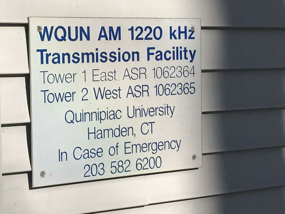 A sign on the side of the  former WQUN transmitter building in Hamden. Photo: Luther Turmelle / Hearst Connecticut Media File